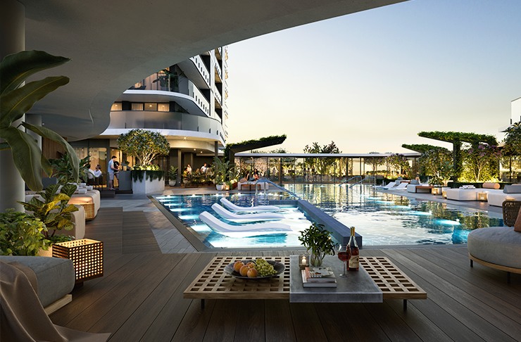 A luxury rooftop pool with lounge chairs and plants surrounding the pool deck.
