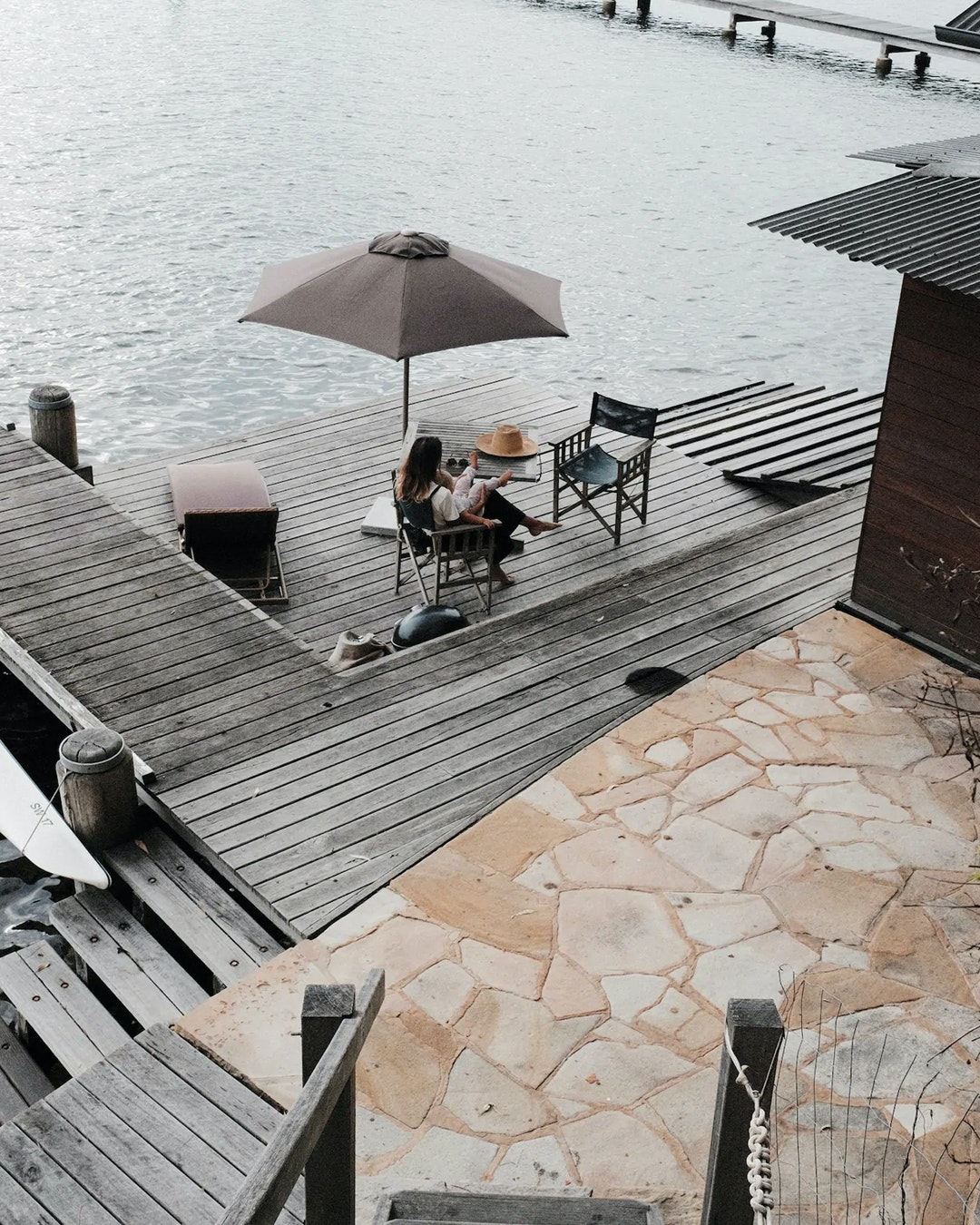 stairway leading down to girl reading on daybed on pontoon