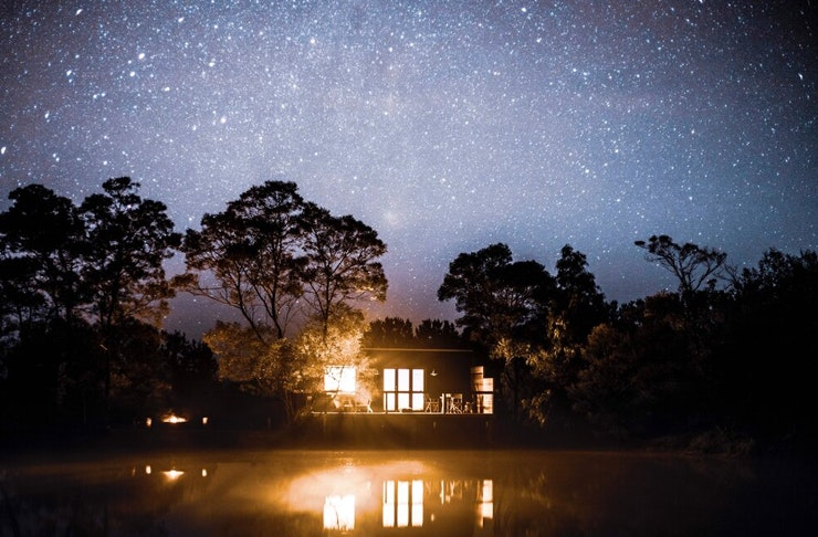 night view of southern highlands cabin with sky full of stars