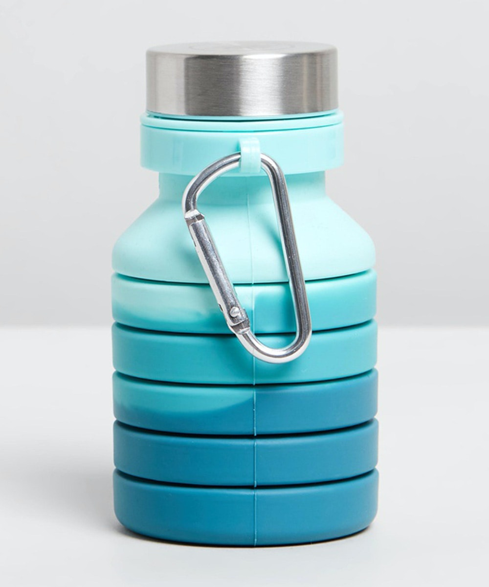 an ombre blue water bottle that has a collapsable body.