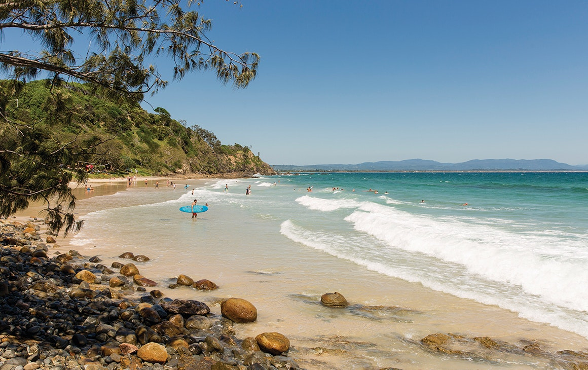 a stunning view of a beach at byron bay with a blue sea.