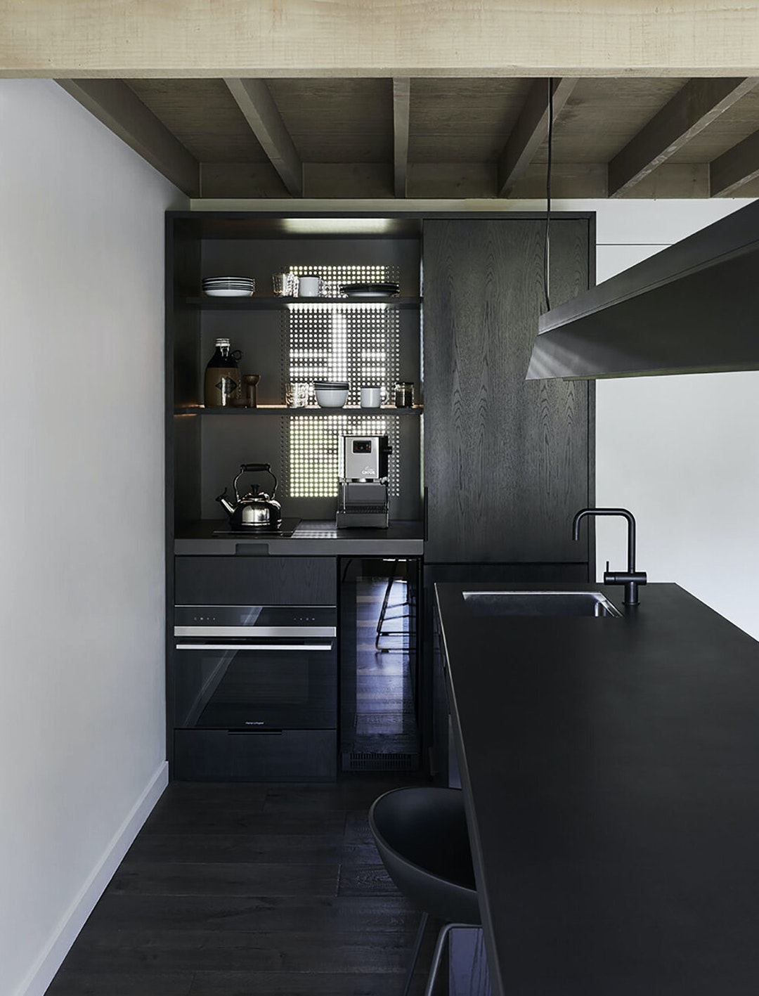 inside kitchen of cedar cabin decked out in all black trimmings