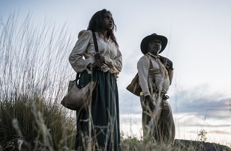 two indigenous people standing on hill in warwick thornton's 2017 film sweet country