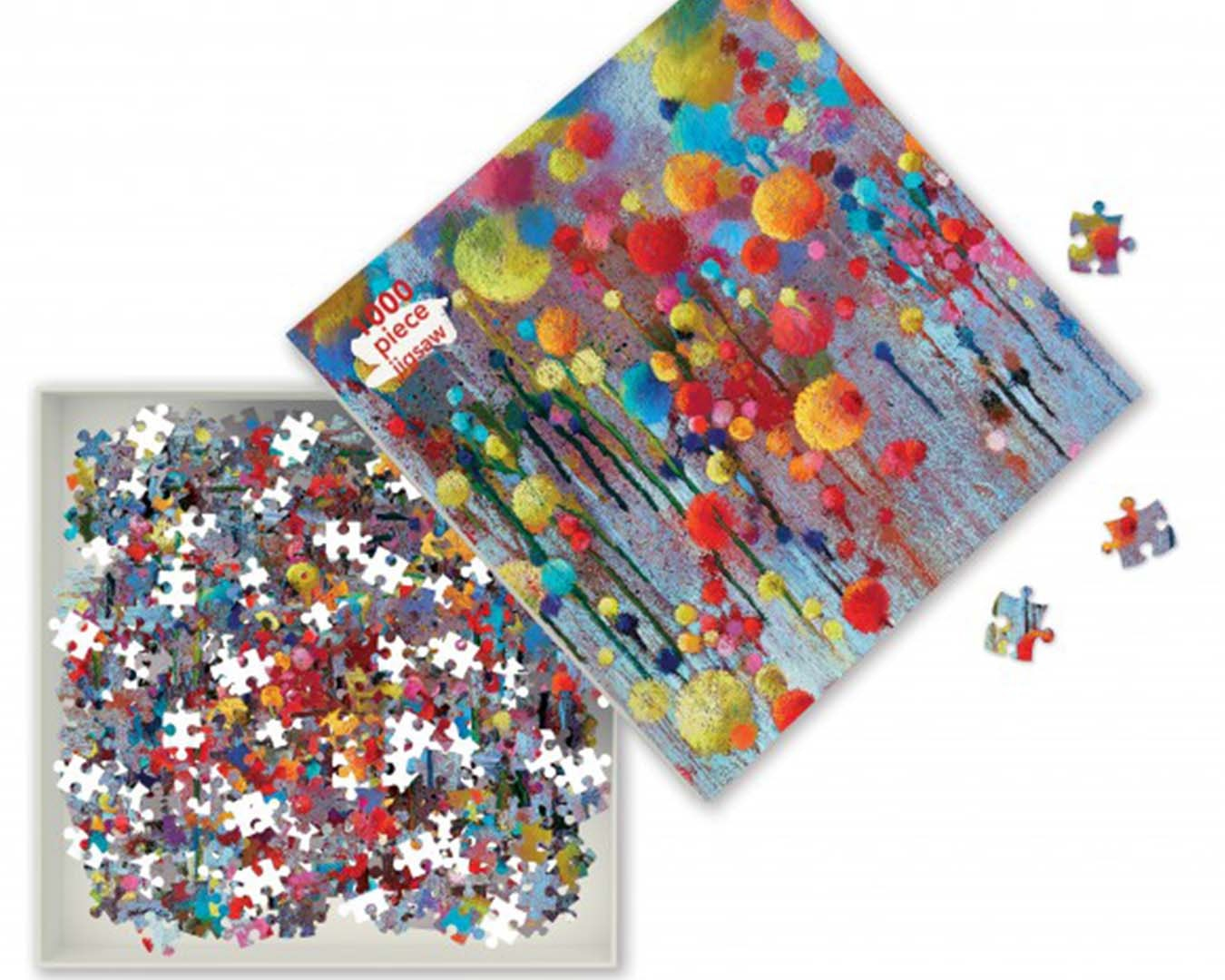 Open puzzle box showing a mixture of puzzle pieces and a colourful print on the box.