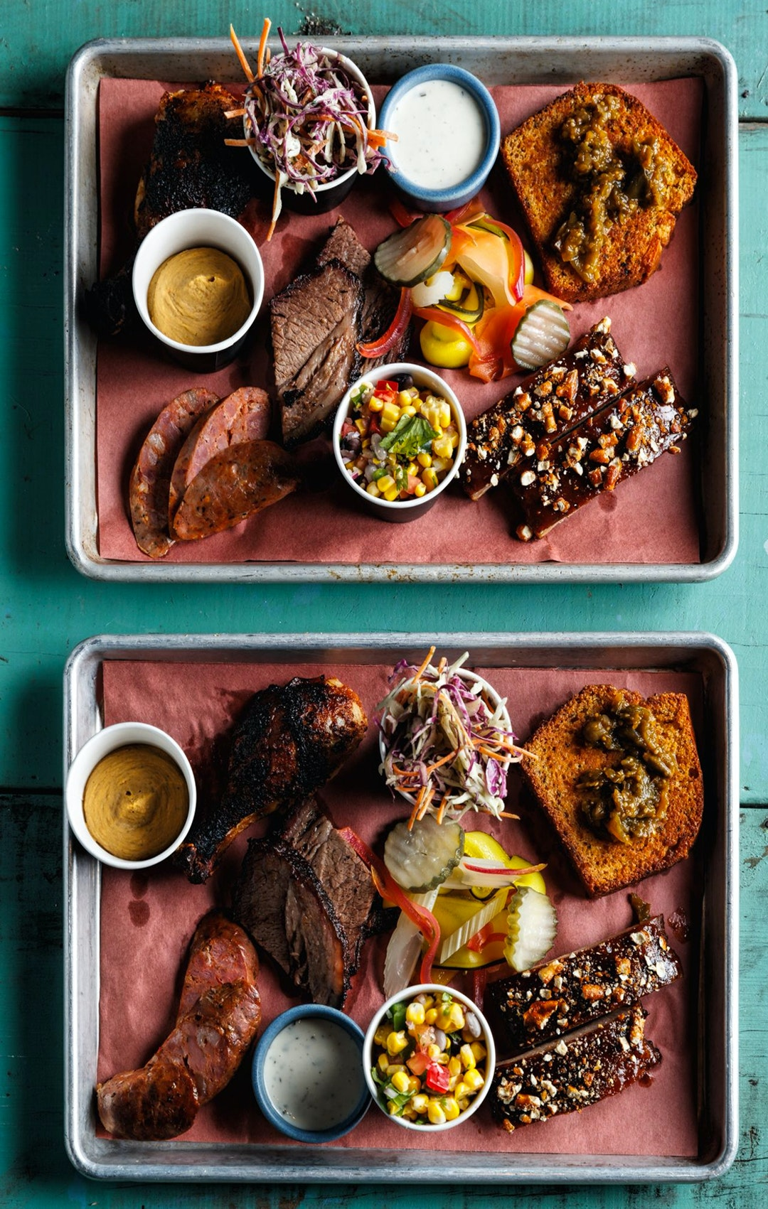 platter of slow cooked meats with sides from nola meathouse