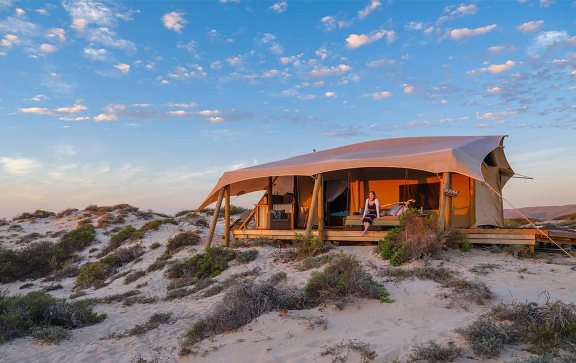 a glamping tent pitched in the sand dunes in WA.