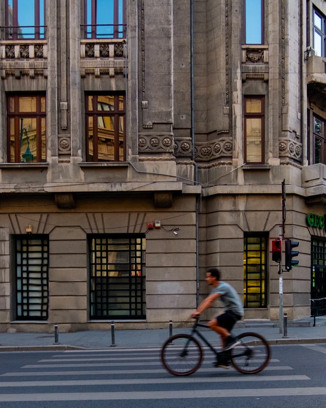 young man cycling through Sydney's CBD