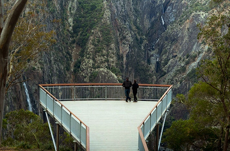 two people standing on the edge of new lookout at wollombombi lookout in NSW