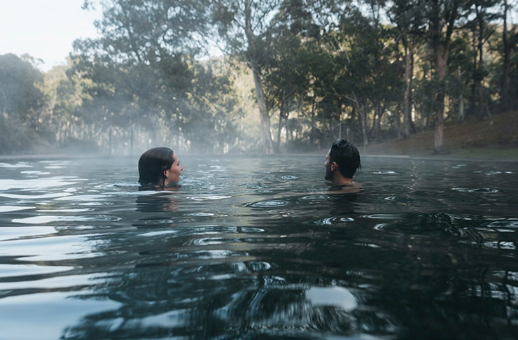 two people in the yarangobilly caves thermal pool
